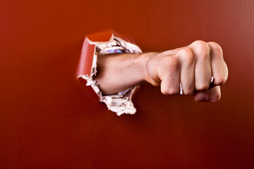 iStock_Hand through wall - Small